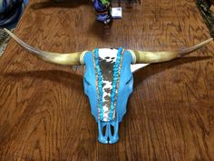 A personal favorite from my Etsy shop https://www.etsy.com/listing/255746338/decorated-cow-skull-with-turqoise-stones