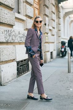 When Olivia exited the MSGM show in Milan, she showed off another unexpected look, rocking a printed suit with an equally bold printed blouse — oh, and printed loafers, too.