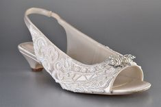 A Gorgeous Bridal Slingback low heeled shoe covered on both sides with beautiful venise lace! These Shoes are an exquisite example of what Pink2Blue
