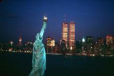 Burt Glinn 1986 USA. New York City. 1986. The Statue of Liberty with the World...
