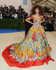 Met Gala 2017 Celebrity Red Carpet Outfits: The 2017 Met Gala red carpet is officially happening, and we would never dream of letting you miss a single standout look. We'll be here all night gathering the most out-there and most beautiful looks of the night. -- Zendaya, MetGala 2017, in a yellow and red gown. | Coveteur.com