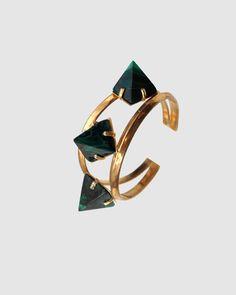 3 stone cuff with pyrite, clear quartz, or malachite pyramids.