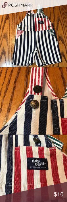 OshKosh B'Gosh striped overalls. 24 Months OshKosh B'Gosh Navy And White striped overalls with red accents. 24 Months. Cotton. OshKosh B'gosh Bottoms Overalls
