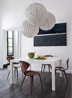 Minimalist dining room with dramatic lighting