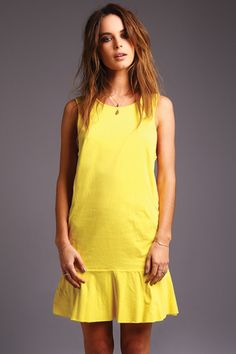 This Yellow Love dress has a drop waist and is made from organic cotton.