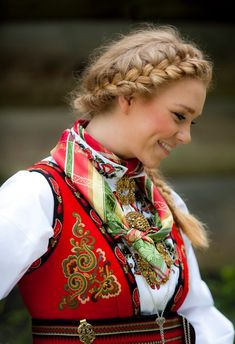 ((LOVE THIS BRAIDED HAIR!!)) National Costume (Bunad) from East Telemark, Norway - Isn't she a natural beauty!!This picture is in my mind, something of a likeness when my grandfather first met my grandmother in Norway. He mentions her natural beauty and it was something he loved about her.