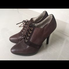 New Michael Kors Brown Leather Bootie size 6 Classic, yet very stylish, trademark of Michael Kors vision of line! Brown leather bootie with brown suede accents and front lace closures. Very chic and well done stitching with a raised sole and sexy heel. This will be sure to turn heads at the office or at a nicer day event. Never worn item, without the tag or the box. Thank you. Michael Kors Shoes Ankle Boots & Booties