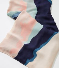 $34.50 Super soft an light-weight this watercolor inspired scarf ties you up in artful chic