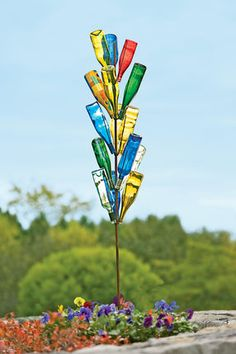 Placing empty glass bottles in the garden began as a way to capture evil spirits. These days, a bottle tree is an easy way to create one-of-a-kind garden art. Set includes steel tree tall) and 18 colorful bottles to arrange and rearrange! Wine Bottle Trees, Wine Bottle Crafts, Bottle Art, Wine Tree, Diy Wine Bottle Bird Feeder, Blue Bottle, Bottle Lights, Empty Glass Bottles, Bottles And Jars