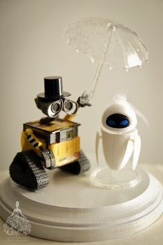 Why settle for a generic cake topper when you can create something truly personal and meaningful to you?  Use action figures from toy stores and other creative sources for a one of a kind topper.  Wall-E movie cake topper    http://faith-michele.com/heather-jorges-wedding-at-angeles-national-golf-club/