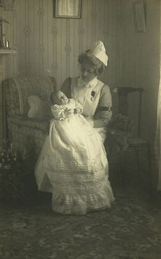 Unidentified nurse with baby