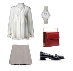 Look para ir a trabajar con falda de estampado pata de gallo y camisa blanca