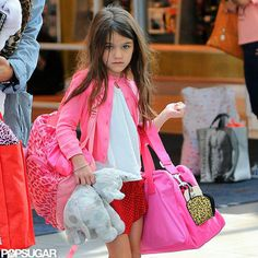 """I have learned how to carry my own bags with style, though. And believe me, it wasn't easy."" - Suri's burn book, hilarious!"