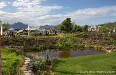 A wetland pond and secure residential eco village park created by Style Council Exterior Designers. Residents enjoy connecting with neighbours and with nature in the space