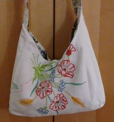 The first bag I made from a vintage 1950s embroidered tablecloth.  Linen lined with recycled flowered cotton