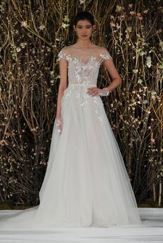 Tulle gown with illusion neckline and floral details | Mira Zwillinger Spring 2017 | https://www.theknot.com/content/mira-zwillinger-wedding-dresses-bridal-fashion-week-spring-2017