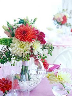 Set the scene for a gorgeous wedding reception with our ideas for fresh, flower-filled centerpieces. The materials and flowers used in your centerpieces are great launching points for the rest of your wedding decorations. Colorful Centerpieces, Wedding Vase Centerpieces, Wedding Decorations, Centerpiece Ideas, Dahlia Centerpiece, Vase Ideas, Wedding Bouquets, Wedding Flowers, Bridesmaid Bouquets