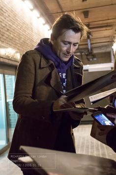 David Tennant signing autographs for fans outside the Barbican