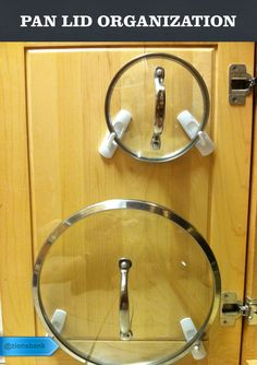 Use adhesive hooks to keep your pan lids organized and out of the way.