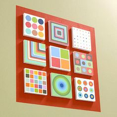 DIY Artwork With a little paint and some foam-core board, nine fun cards form a spiffy piece of artwork. Choose a boldly patterned card then use spray adhesive to mount onto same-size pieces of foam-core board. Attach the squares to the painted square with double-sided carpet tape, and voila! For an extra touch paint a large square in a contrasting color to make your art work pop off your walls.