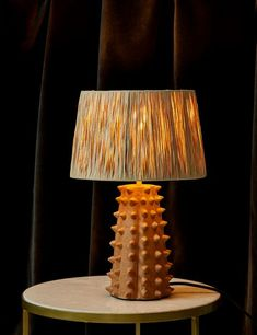 Tan Spiked Terracotta Table Lamp with Raffia Shade