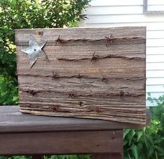 Rustic Wooden Flag With Barbed Wire Stripes and Tin Star