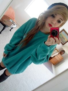 I like the idea of oversized sweaters and tights.  Not crazy about the color though.