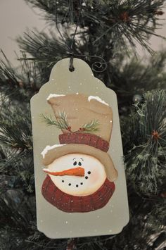 A friendly snowman graces this tag style, wooden ornament. Painted with acrylics and sealed with a matte finish, this Chris Haughey & Laurie