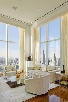 New York City Penthouse Love the high ceilings and the wall of windows.