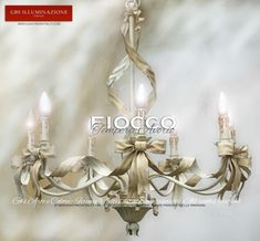 Bow Chandelier in ivory white tempera, with ribbons and bows.