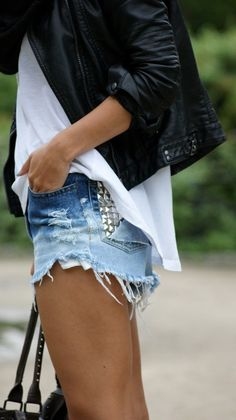denim shorts ; white shiffon shirt ; black leather jacket