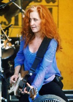 Bonnie Raitt  (born 1949) American blues singer and songwriter, political activist. This famous singer with her signature red hair and streak of blonde/white is also a Grammy Award winner.