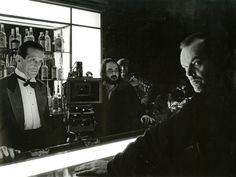 Stanley Kubrick on the Gold Room Bar set of The Shining, with actors Joe Turkel and Jack Nicholson.