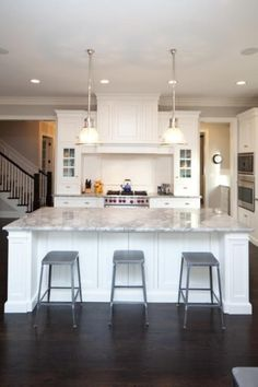 white cabinets, dark floors, old schoolhouse lighting, metal barstools...this is how I am refinishing my kitchen...eventually!