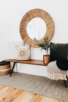 oversize round wood mirror with a midcentury modern style bench and cozy pillows and throws to add warmth(Mix Wood Living Room) Decor, Interior, Round Wood Mirror, Living Decor, Home Decor, House Interior, Room Decor, Apartment Decor, Home Deco