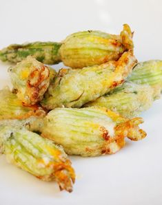 Zucchini blossoms stuffed with ricotta and batter dipped. Delicious!