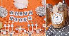 cute orange & gray baby shower- love the bright backdrop and the poms!