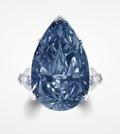 The Blue Ice - A rare fancy deep blue diamond ring set with pear shape diamond shoulders.