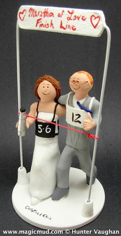 """Wedding Cake Topper for Marathon Runners  This Joggers's Wedding Cake Topper is perfect for a fleet footed couple that has no problem """"getting to the Church on time""""...   $240 the runners bib's that they are wearing spells out their wedding date to the cheering crowd watching them cross that """"matrimonial finish line!""""   ...   design your own custom wedding cake topper call 1 800 231 9814 ...#runners#joggers#wedding#cake#topper#custom#personalized#bride#groom#marathon#athletes"""