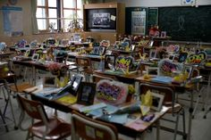Ansan, South Korea Flowers and notes from colleagues paying tribute to the victims of the Sewol ferry are seen in a classroom at Danwon High School.