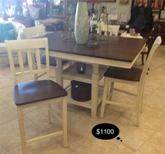 Square, counter height dining table, with storage shelving, 4 chairs, and a leaf. Rich cherry finish to the top and seats of the chairs complete this darling shabby chic farm house styling.    Yesterdays Treasures Consignment  5829 Lone Tree Way Suite J  Antioch, CA 94531  925.233.4547  www.Yesterdayststore.com  Info@yesterdayststore.com