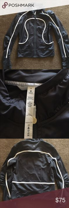 🆕Lululemon Tracker Jacket Gently worn (a few times) dark gray jacket with white detail thumb holes. Made of nylon, lycra & tactel. Perfect for any work out. Smoke & pet free home. lululemon athletica Jackets & Coats