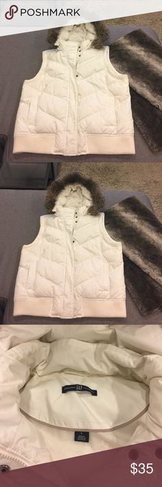 New GAP white fur puffer down vest. Size large White faux fur hooded puffer vest by GAP. Down and super comfy, warm size large very spacious and roomy. New excellent condition selling much cheaper or best offer! GAP Jackets & Coats