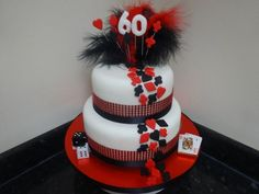 Las Vegas themed 2 tier cake with bling trim, feathers and wired decorations! 2 Tier Cake, Tiered Cakes, Vegas Cake, Wow Factor, Casino Party, Celebration Cakes, Wow Products, Feathers, Las Vegas