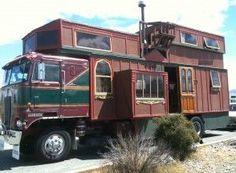 house built on firetruck/garbage-truck body