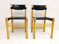 mid century modern chairs made in Italy by Ibisco with black thick leather seats