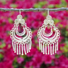 """These incredible filigree earrings made of .900 silver were meticulously handmade in La Paz, Bolivia. Because they are less than .925 silver, they aren't considered """"sterling silver""""...but in our eyes"""