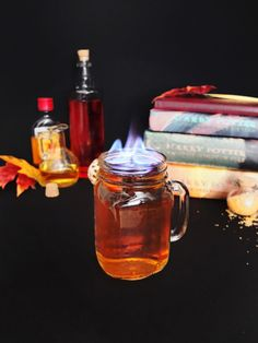 Harry Potter themed cocktail made from butterbeer and firewhisky. Perfect for Harry Potter themed parties. Also a great flaming Halloween cocktail or fall cocktail. Fire cocktails. // www.ElleTalk.com #WhikseyCocktail #ElleTalk #CocktailRecipe #DrinkRecipe