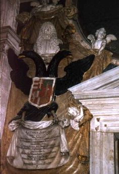 A Baroque tomb in Venice (San Marco?). The deceased is Lazaro Ferro (died 1692), and the arms are: Argent a double-headed eagle displayed sable, armed, beaked and each head crowned or; on its breast an escutcheon: per pale, I. quarterly, 1. barry argent and gules, 2. gules a patriarchal cross argent on a mount vert, 3. gules a lion argent crowned or, and 4. quarterly argent and gules; II. Gules on a wheel or a tree vert climbing thereon at dexter a woodpecker proper… (photo © F. Velde)