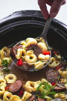 Slow cooker Italian sausage tortellini soup with red peppers, onions, spicy…